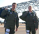 pilots standing on tarmac